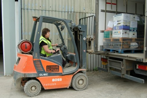 Marj loading an order into one of our lorries